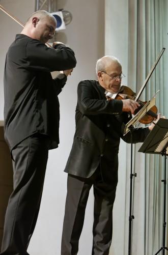 >Солистите в концерта - баща и син Минчеви, са носители